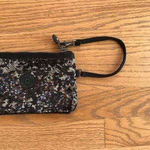 Kipling - sequin wristlet pouch